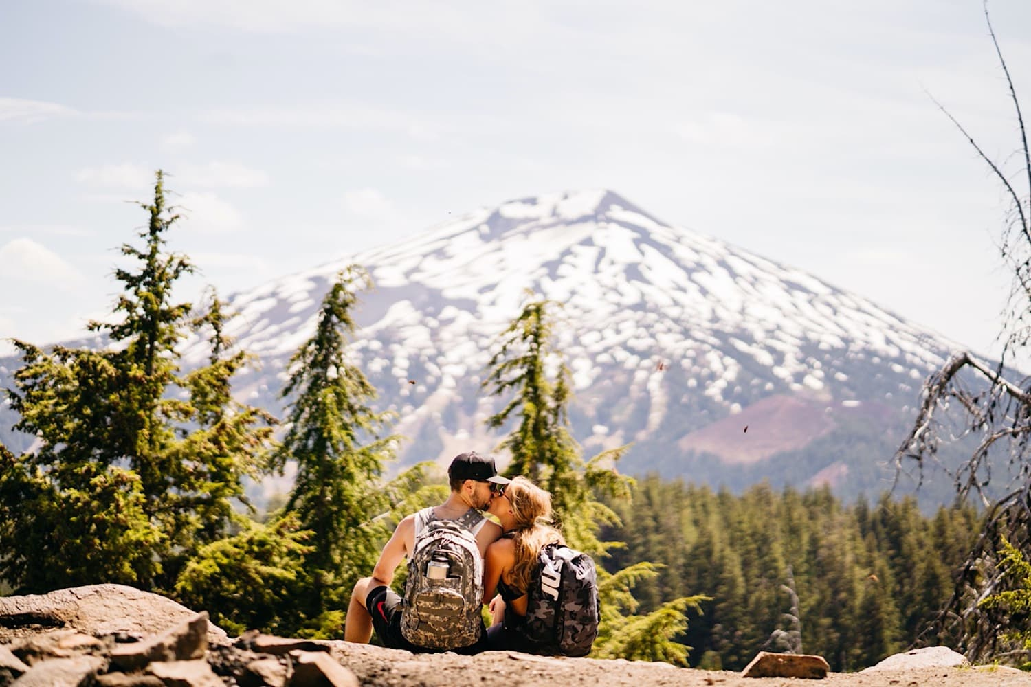 couple kissing by Mt Bachelor